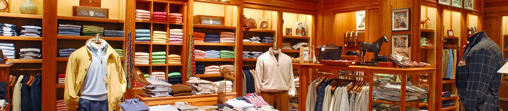 Mannequins dressed up in men's golf attire in the men's clothing section